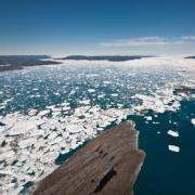 Icebergs choke the fjord where Jakobshavn glacier flows into the sea off western Greenland
