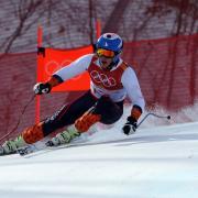 Junior JT Abate skiing