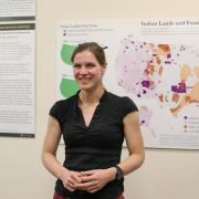 Jordan Wirfts-Brock stands in front of her first-place winning project