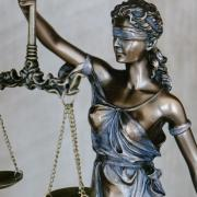 Statue of Justice with scales