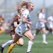 Kayleigh Webb runs with soccer ball
