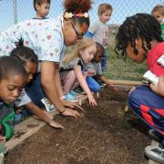 Kids work in a garden on Earth Day