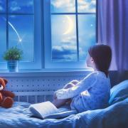 Illustration of child watching the stars from her bed