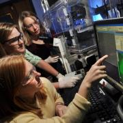 Researchers collaborate in lab