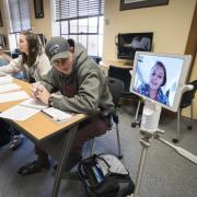 Student participates in classroom remotely using Kubi technology