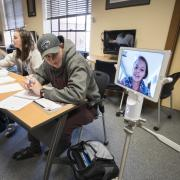 Students using a Kubi device for distance learning