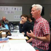Instructor Tyler Lansford coaches 'Julius Caesar' actors in rhetoric