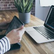 A person with a laptop and tablet. (Lara Far on Unsplash)