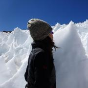 Lara Vimercati examines a nieves penitentes structure on Volcán Llullaillaco in Chile