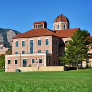 Leeds School of Business agains the background of the Flatirons