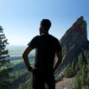 Man standing on mountain top.