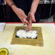 Student rolling sushi