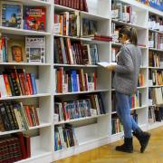 Woman peruses books at a library