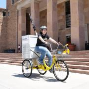 Woman on library bike in front of Norlin Library