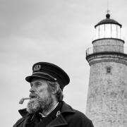 Black and white photo of Willem Dafoe and Robert Pattinson in The Lighthouse film