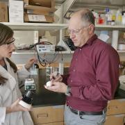 Professor Karl Linden, right, in his laboratory at CU Boulder