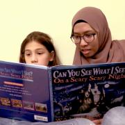 Student reads with a child