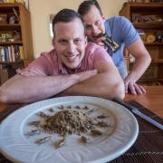 Dave Baugh with plate of crickets; Lars Baugh eats Lithic Nutrition cricket bar