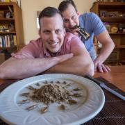 Brothers display their insect food product including crickets on a plate.