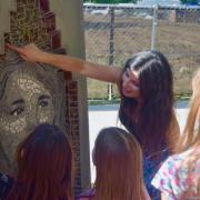 Jasmine Baetz talks to CU Science Discovery campers about one of the mosaic portraits. (Photo by Lisa Schwartz, CU Boulder)