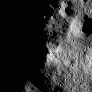 An image of the lunar surface partially in shadow.