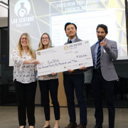The Sick Stick team posing with a large check at the 2019 Lab Venture Challenge
