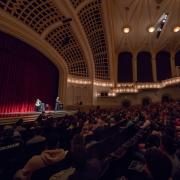 Speaker addresses crowd in Macky Auditorium