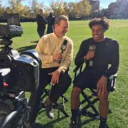 Mark Johnson interviewing cornerback Isaiah Oliver after a CU football practice