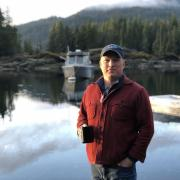Markos Scheer in front of lake, mountains