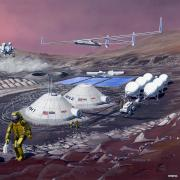 an illustration of possible future transit vehicles, habitats, and power systems on Mars