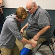 Max Armstrong performs prosthetic socket fitting