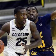 Colorado's McKinley Wright IV, left, drives past a Cal player during a Pac-12 Conference basketball game
