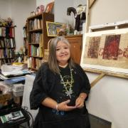 Photo of printmaker Melanie Yazzie in her studio
