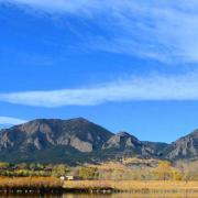 A wide image of the CU Boulder South property with the Flatirons in the background