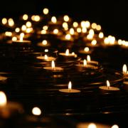 Stock image of lit memorial candles