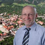 Provost Moore against a background of the university