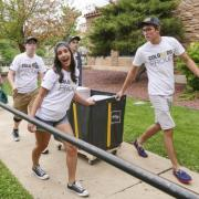 Students pulling a cart for move in day
