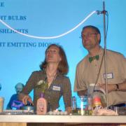 CU Boulder JILA researchers Margaret Murnane and Henry Kapeteyn demonstrate an experiment during a CU Wizards event. (Photo by Casey Cass/University of Colorado)