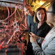 Henry Kapteyn and Margaret Murnane talk to graduate student Qing Li in their lab at JILA