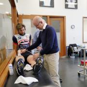 Inigo San Milan treating a cyclist with his glycogen testing invention.