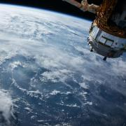 A photo of a satellite in orbit above Earth (Photo credit: NASA)