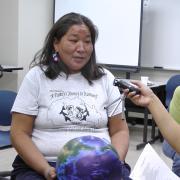 Navajo women being interviewed for radio broadcast