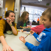 Students affiliated with CU Boulder's Intermountain Neuroimaging Consortium teach elementary school students about the brain