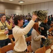 Incoming students shake pompoms during the spring 2018 New Student Welcome Day.