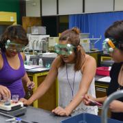 Glenwood High School senior Keyla Contreras and Summit County High School students Lizbeth Serrano and Nancy Higuera in an advanced chemistry lab at CU Boulder last summer.