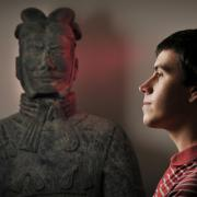 Student Nick Bertrand with terracotta warrior statue