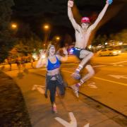 Students run in the 2015 Nearly Naked Mile
