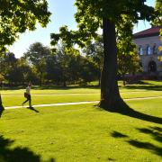 A man walks on Norlin Quad.
