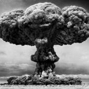 Black and white photo of mushroom cloud from nuclear explosion