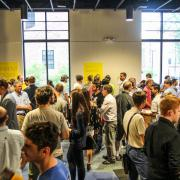 People mingle at New Venture Challenge event